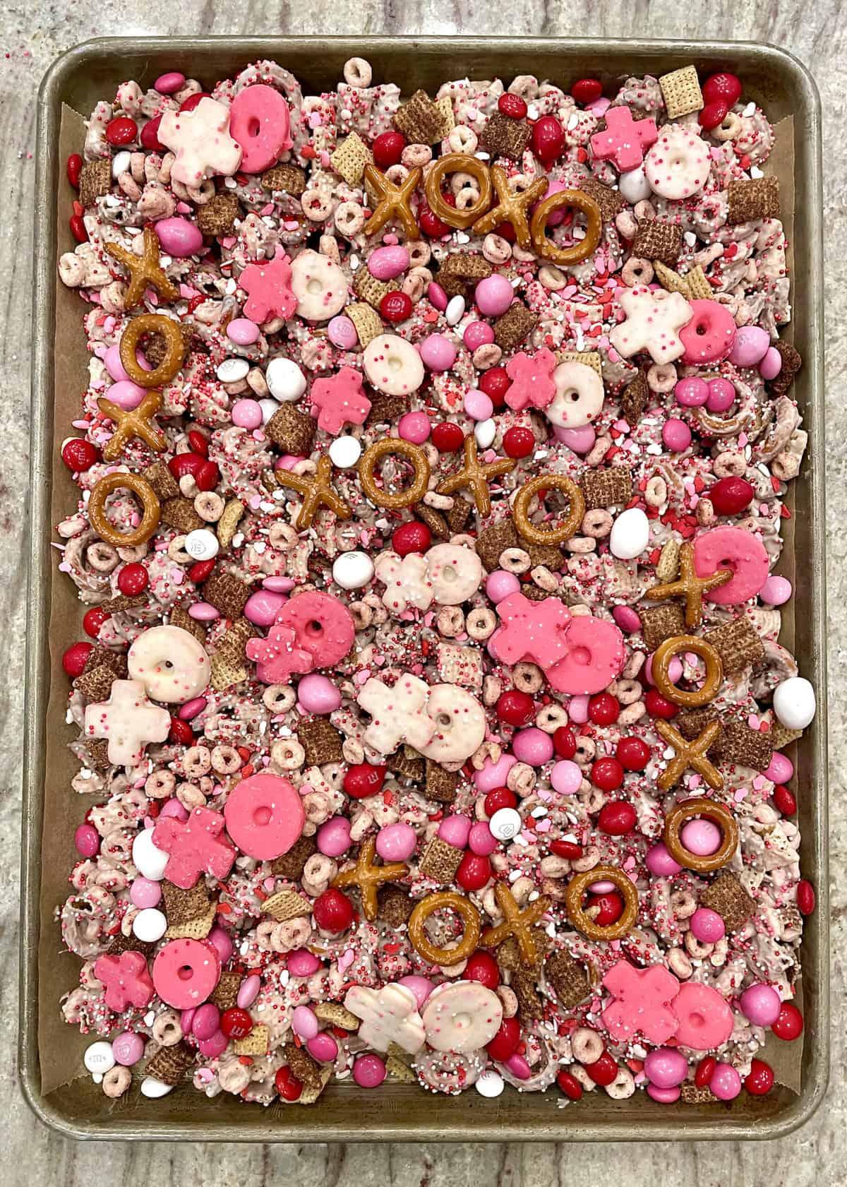 Finished XOXO Valentine's Day Snack Mix on a Baking Sheet