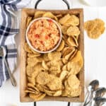 Pimento Cheese Dip on a tray with chips by The BakerMama